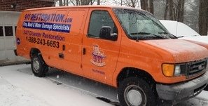 Water Damage Huson Van At Winter Residential Job Site