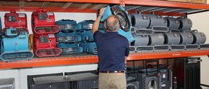 Water Damage Restoration Technician Prepping Air Movers