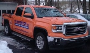 Water Damage Restoration Truck At Winter Flooding Site