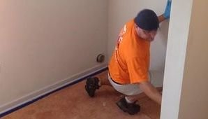 Water Damage Technician Doing Final Checks After Mold Cleanup Job